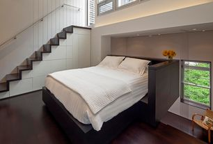 Modern Guest Bedroom with Hardwood floors, High ceiling