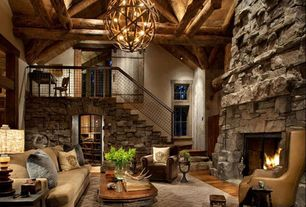 Rustic Living Room with flush light, Colorado Gray / Stack Stone, Loft, Barn door, Twig sphere chandelier or pendant light