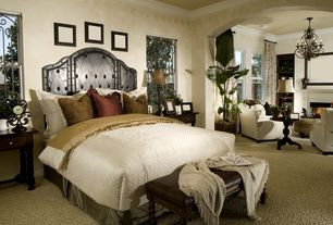 Traditional Master Bedroom with Crown molding, Carpet, Fireplace, Cement fireplace, Paint, interior wallpaper, Chandelier