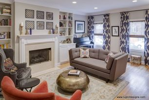 Eclectic Living Room with Cement fireplace, Fireplace, Built-in bookshelf, Paint, double-hung window, Crown molding