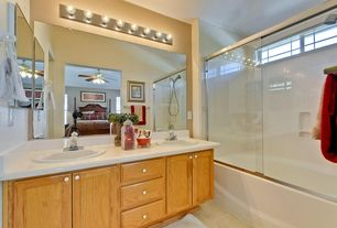 Craftsman Full Bathroom with Wall sconce, picture window, Standard height, Built-in bookshelf, limestone floors