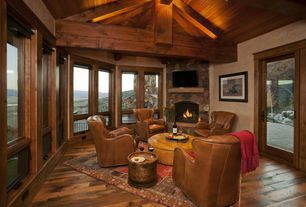 Rustic Living Room with Paint 2, Casement, Exposed beam, French doors, Fireplace, Paint 1, Hardwood floors, Standard height
