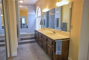 Traditional Master Bathroom with Wall sconce, Sliding mirror closet door, Carpet, Tile wall, Frameless wall mirror