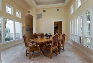 Contemporary Dining Room with travertine floors, Wall sconce, 24?24 Light Honed & Filled Travertine Tiles, Cathedral ceiling