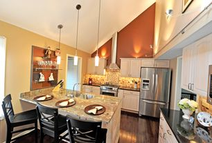 Modern Kitchen with Breakfast bar, Wall sconce, Absolute black granite, Raised panel, Soapstone counters, Large Ceramic Tile