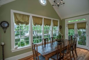 Country Dining Room with Crown molding, French doors, Transom window, High ceiling, Hardwood floors, Chandelier