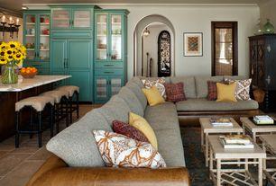 Mediterranean Great Room with French doors, Chandelier, Built-in bookshelf, Concrete tile , Crown molding