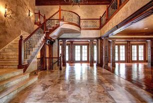 Craftsman Entryway with Chandelier, complex marble tile floors, High ceiling, Wrought iron railing, Columns, Loft