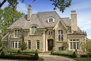 Traditional Exterior of Home with French doors, Pathway, Arched window, Glass panel door, Deck Railing, picture window