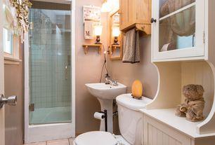 Traditional 3/4 Bathroom with limestone tile floors, Flat panel cabinets, Flush, frameless showerdoor, Glass panel