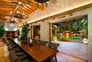 Tropical Dining Room with Exposed beam, slate floors, Selamat barbara arm chair, Chandelier