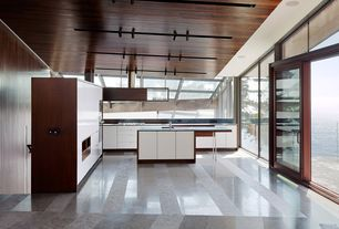 Contemporary Kitchen with L-shaped, double wall oven, Soapstone, Kitchen island, electric cooktop, Soapstone counters, Flush