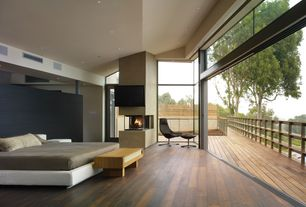 Contemporary Master Bedroom with Hardwood floors, Morocco leather bed, High ceiling, sliding glass door, insert fireplace