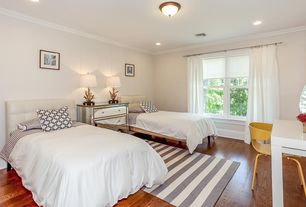 Contemporary Guest Bedroom with Paint, Crown molding, flush light, double-hung window, can lights, Standard height