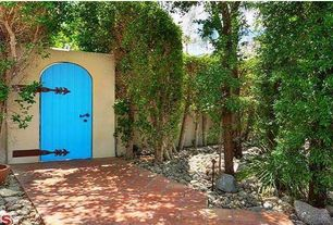 Mediterranean Entryway with Barn door, terracotta tile floors, Standard height