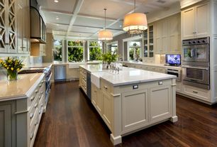 Country Kitchen with Hardwood floors, Kitchen island, Complex Marble, Inset cabinets, European Cabinets, two dishwashers