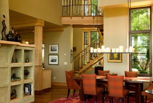Craftsman Dining Room with Hardwood floors, Columns, Ballard design gramercy upholstered chair, Built-in bookshelf, Loft