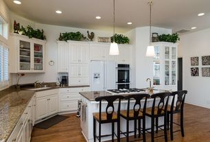 Traditional Kitchen with Pendant light, Breakfast bar, Raised panel, Glass panel, Kitchen island, European Cabinets, L-shaped