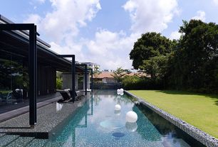 Contemporary Swimming Pool with Infinity pool, Pathway, Fence, exterior stone floors