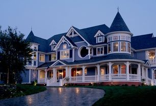 Traditional Exterior of Home with Glass panel door, Covered front porch, picture window, Pathway, Turret room, Paint