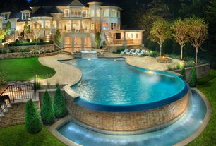Traditional Swimming Pool with Fire pit, Fence, Outdoor kitchen, Infinity pool, Raised beds, Deck Railing, Gate, French doors