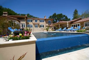 Mediterranean Swimming Pool with Raised beds, Infinity pool, French doors, Arched window, Fountain