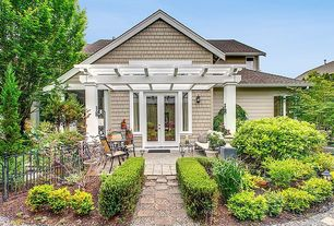 Traditional Exterior of Home with Pathway, Trellis, French doors, Gravel and flagstone path, Box hedge, Patio furniture