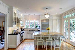Traditional Kitchen with full backsplash, Farmhouse sink, Pendant light, can lights, Wall Hood, Crown molding, gas range