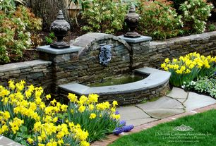 Traditional Landscape/Yard with Fountain, Pathway, Pond, Natural stone, exterior stone floors, Raised beds