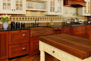 Country Kitchen with Wood counters, Glass panel, Standard height, Flush, One-wall, Flat panel cabinets, Stone Tile