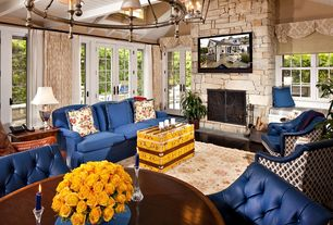 Traditional Living Room with Hardwood floors, French doors, stone fireplace, Chandelier, Exposed beam, Window seat