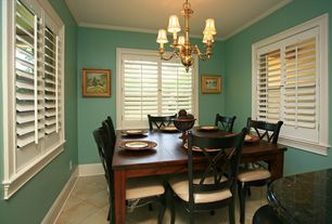 Traditional Dining Room with Crown molding, Chandelier