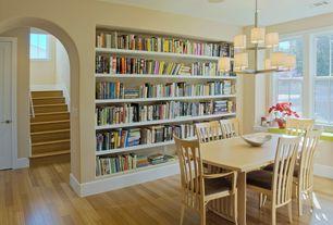 Modern Dining Room with Chandelier, Built-in bookshelf, Hardwood floors