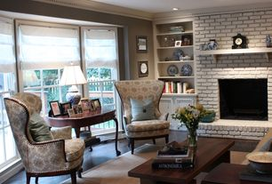 Traditional Living Room with Hardwood floors, brick fireplace, double-hung window, Crown molding, Standard height, can lights