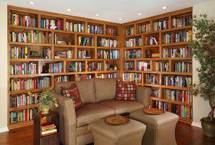 Craftsman Living Room with Built-in bookshelf, can lights, Hardwood floors, Standard height