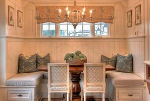 Traditional Dining Room with Hardwood floors, Chandelier, Crown molding, Standard height, Casement, Built-in bookshelf