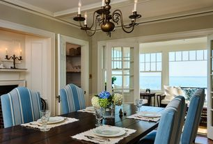 Traditional Dining Room with Fireplace, French doors, Standard height, brick fireplace, Exposed beam, Built-in bookshelf