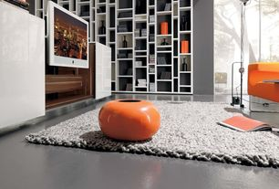 Contemporary Living Room with Standard height, Built-in bookshelf, Concrete floors, picture window