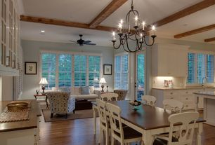 Traditional Dining Room with French doors, Hardwood floors, Chandelier, Built-in bookshelf, Exposed beam