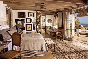 Rustic Master Bedroom with Woven bench, Wooden rocker, Standard height, Folding sliding glass exterior doors, Casement