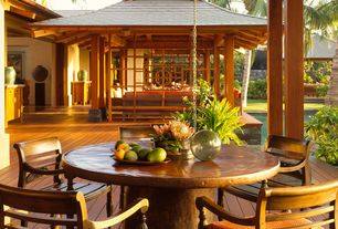 Tropical Porch with Hardwood floors, Pendant light, Columns, Pottery Barn Geneva Concrete Round Fixed Dining Table