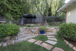 Traditional Landscape/Yard with Bird bath, Raised beds, Pathway, Gazebo, Fence, exterior stone floors