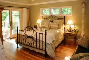 Country Master Bedroom with Hardwood floors, French door, Fashion Bed Grafton Metal Bed in Rusty Gold Finish, Crown molding