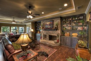 Traditional Living Room with Standard height, interior brick, Fireplace, Built-in bookshelf, Hardwood floors, Crown molding