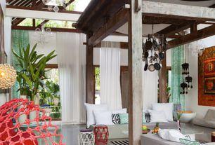 Eclectic Living Room with fenton&fenton Esquelet Chandelier - Medium, simple marble tile floors, Exposed beam, Columns