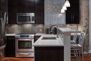 Modern Kitchen with Large Ceramic Tile, Undermount sink, Flush, Ceramic Tile, full backsplash, Corian counters, gas range