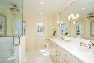 Traditional Master Bathroom with frameless showerdoor, Undermount sink, Master bathroom, full backsplash, Corian counters