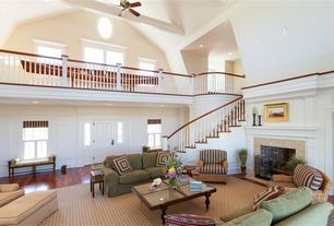 Traditional Living Room with Cathedral ceiling, Ceiling fan, stone fireplace, Loft, Exposed beam, specialty door