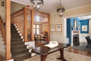 Craftsman Entryway with Hardwood floors, Crown molding, flush light, Standard height, Columns, Wainscotting