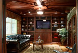 Traditional Living Room with Standard height, double-hung window, Hardwood floors, Built-in bookshelf, flush light